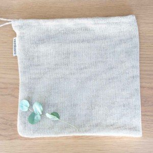 Reusable cotton and linen produce bag on table