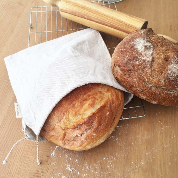 Two loaves of artisan bread with a verdonce recycled cotton produce bag and a rolling pin