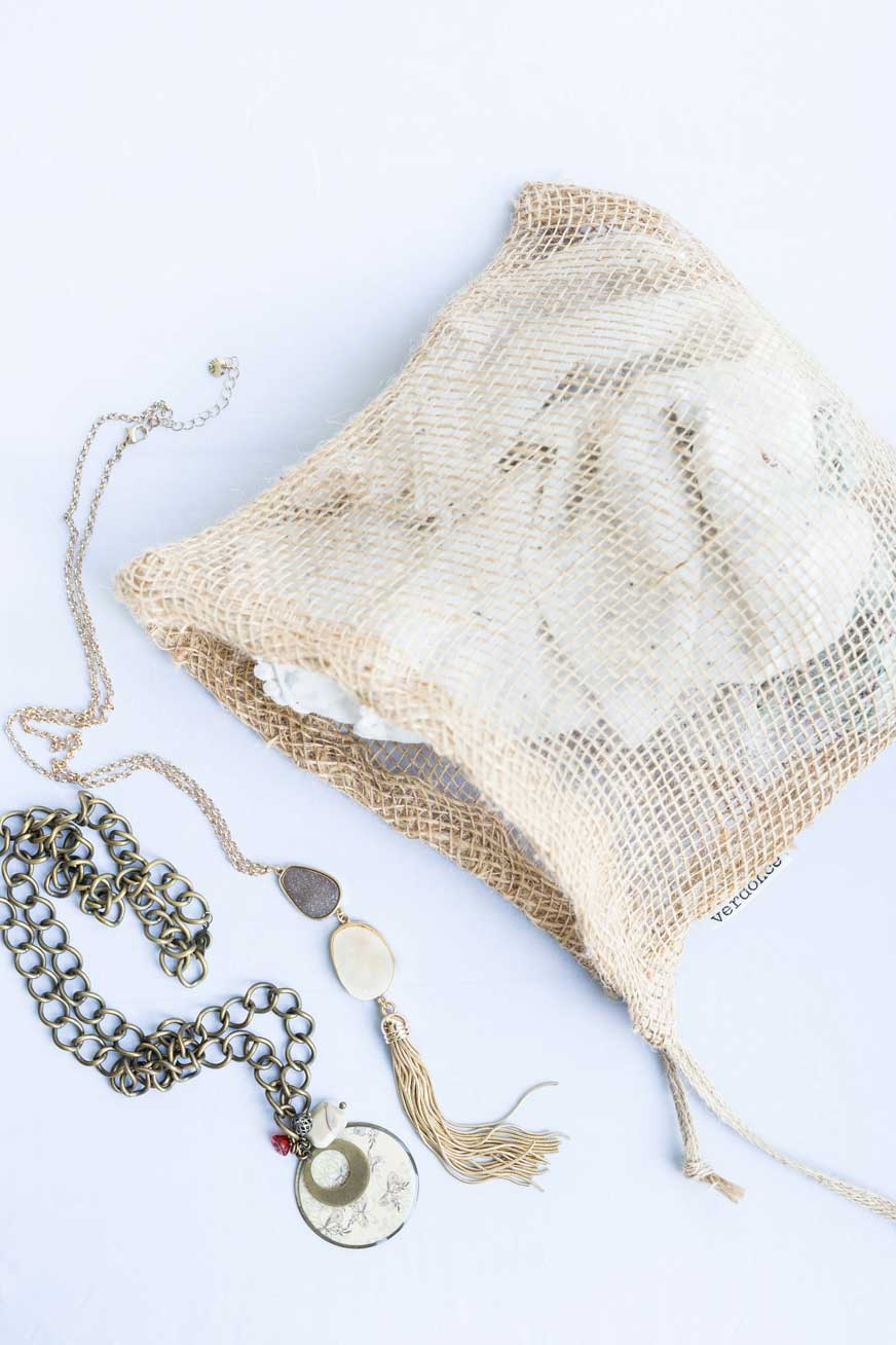 Necklaces and jewelry in a Verdonce natural jute cloth bag