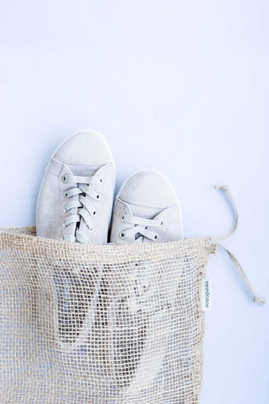 Sneakers in a Verdonce natural jute fibre bag