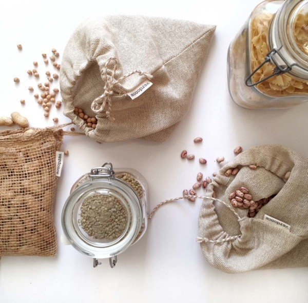 Natural produce bags with legumes and jars