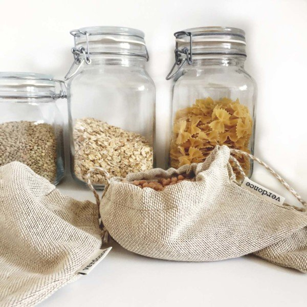 Bulk shopping bags with produce and jars