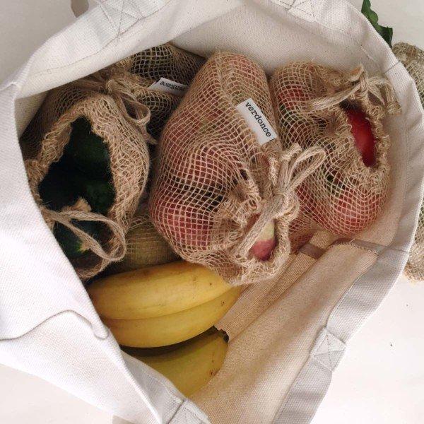 Minimalist canvas tote bag showing produce zero waste produce shopping