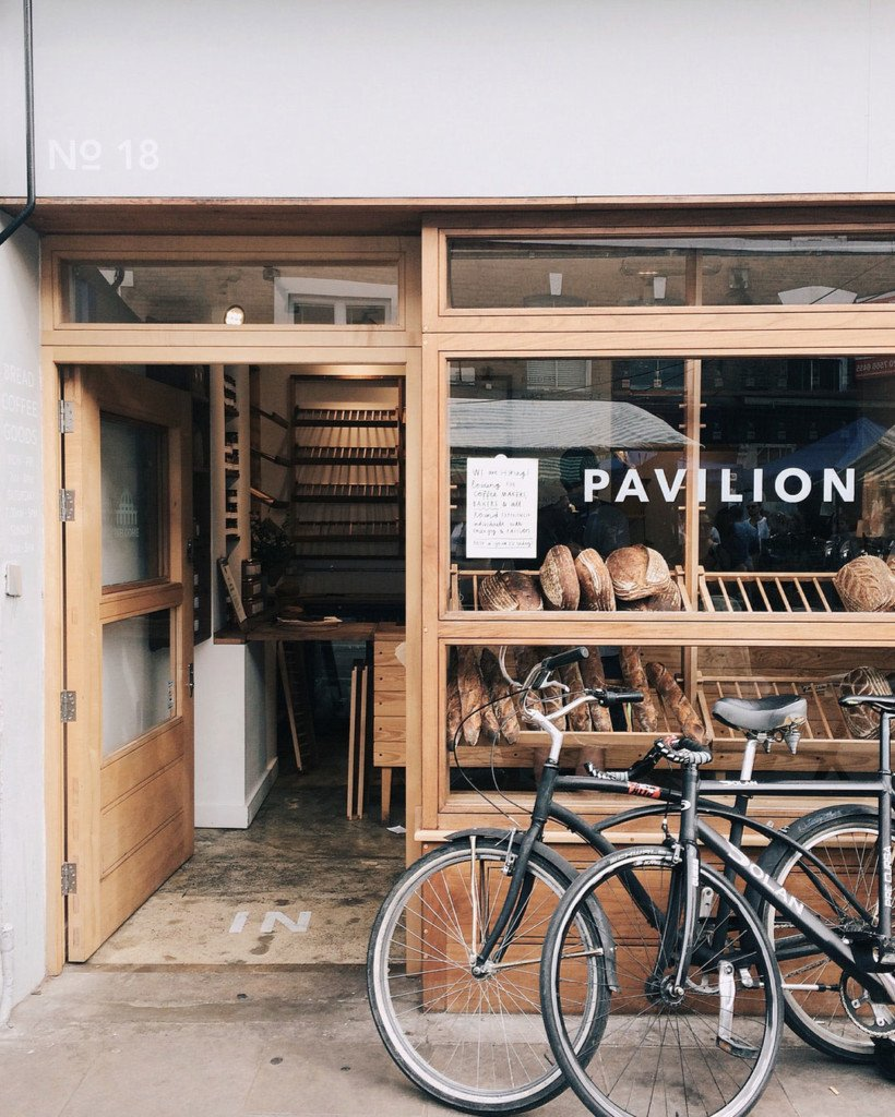 Two bikes outside an artisan bakery