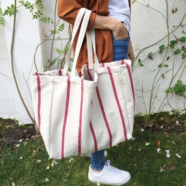 Woman holding deep red tote