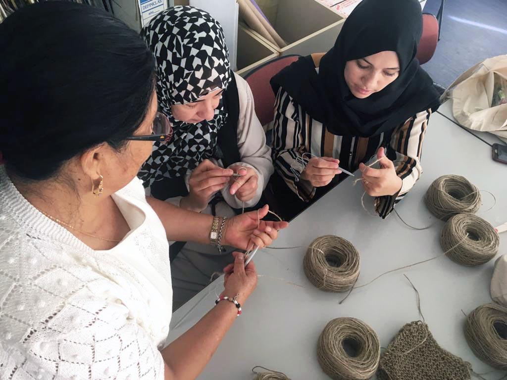 Group of women knitting Verdonce scrubbing cloths from natura jute yarns