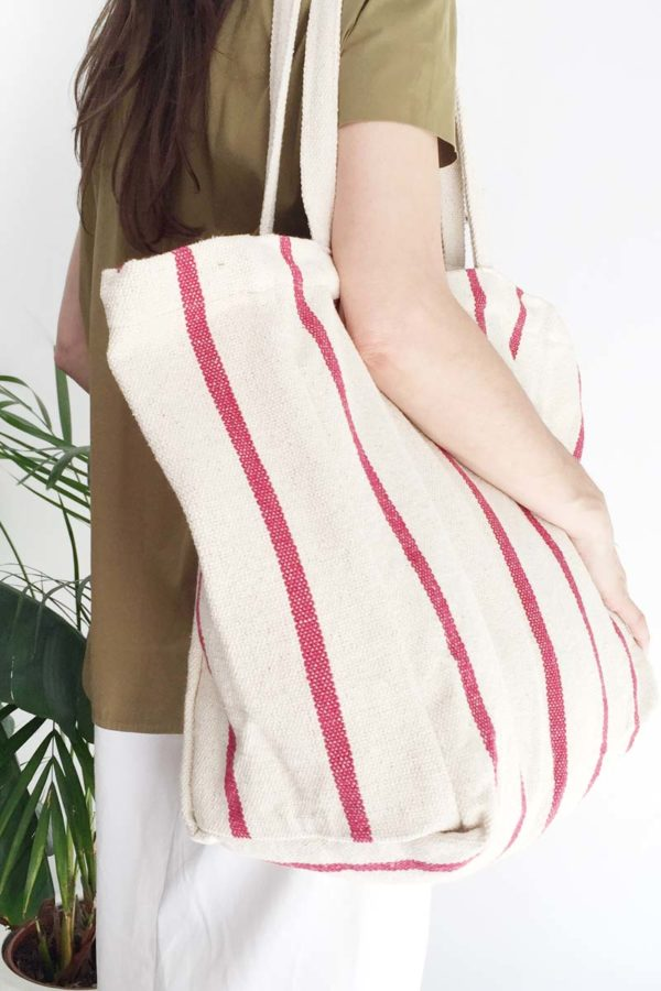 Close up of verdonce maxi tote with deep red stripes