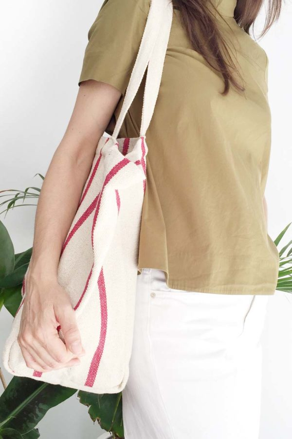 Woman carrying verdonce tote on shoulder