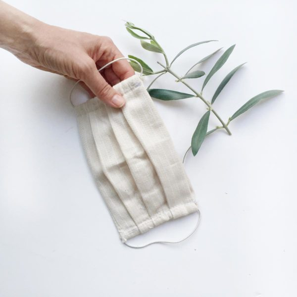 Reusable face mask with olive twig and hand