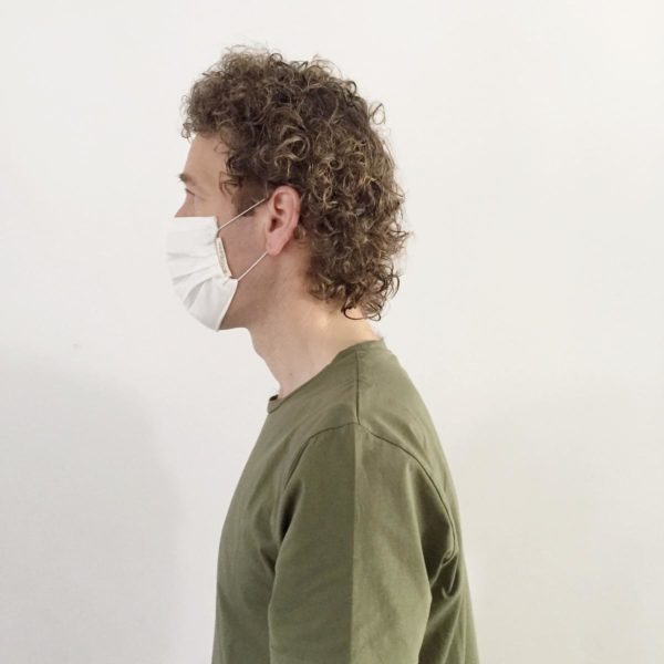 Man from side wearing a ecological face mask