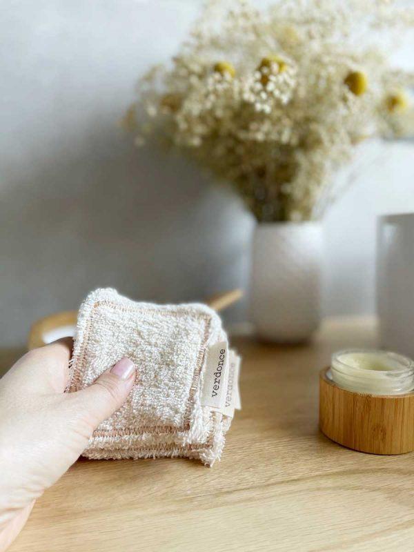 hand holding set of reusable facial pads