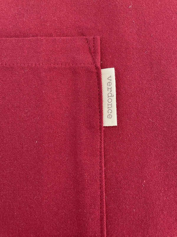 close up of the verdonce recycled cotton apron showing the maroon colored fabric