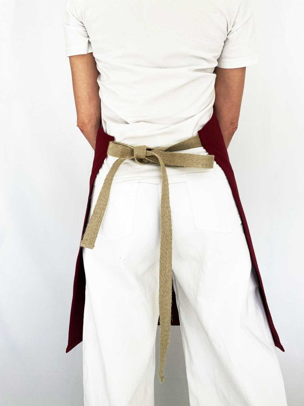rear view of hemp straps on verdonce recycled cotton apron in maroon colour