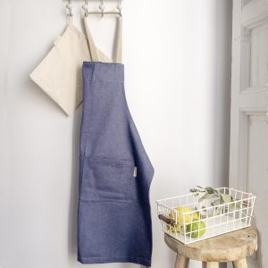 verdonce recycled denim apron with hemp straps hanging on wall