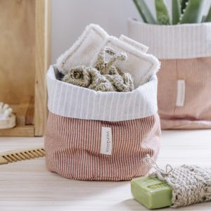 Close up of Verdonce eco basket with eco bathroom products in argan and stone striped recycled cotton