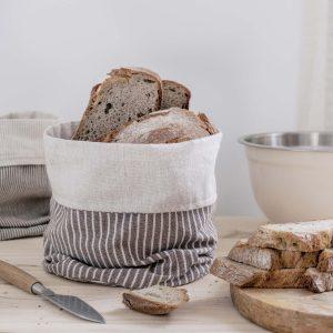 Cesto eco Verdonce color almendra-avena en la cocina con pan